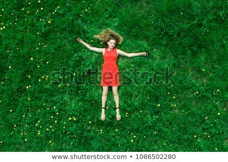 fiatal · szexi · nő · visel · vörös · ruha · pózol · lépcsősor - stock fotó © iofoto