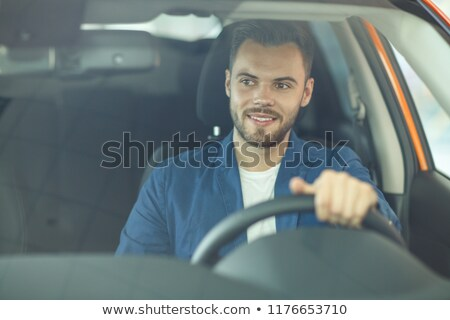 Stock photo: Smiling young male dealer in suit
