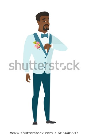 Disappointed african groom with thumb down. Stock photo © RAStudio