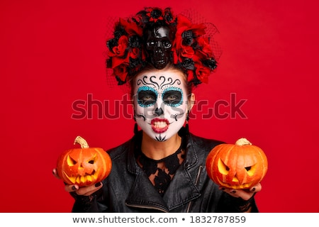 two excited young women in leather halloween costumes stock photo © deandrobot