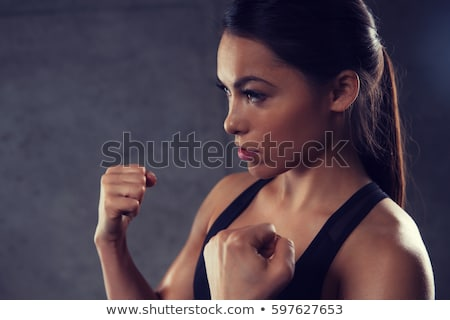 Nő tart harcol tornaterem sport fitnessz Stock fotó © dolgachov