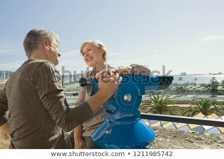 Para teleskop kobieta człowiek podróży zabawy Zdjęcia stock © IS2