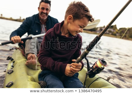 close up of man fishing in a kayak stock photo © 2tun