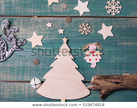 Merry Christmas. Retro Santa Claus with a deer flying on a rocke Stock photo © studiostoks