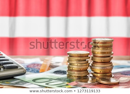Euro banknotes and coins in front of the national flag of Austri Stock photo © Zerbor