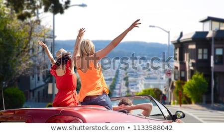 friends driving in car at san francisco stock photo © dolgachov
