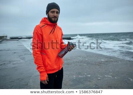 Caminando aire libre playa escuchar música Foto stock © deandrobot