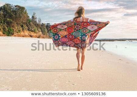 Carefree girl walking along the beach early morning Stock photo © lovleah