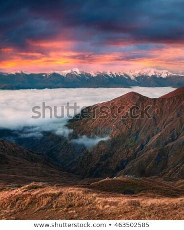 Gyönyörű napfelkelte hegyek tó Grúzia hegy Stock fotó © Kotenko