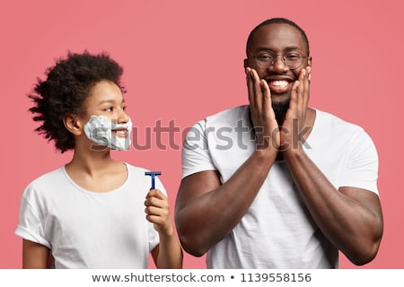 Man shaving isolated on background  Stock photo © Massonforstock