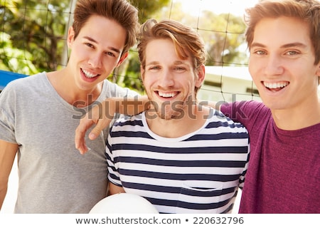 smiling young man with volleyball Stock photo © dolgachov