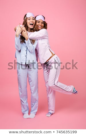 Two pretty girls wearing pajamas isolated Stock photo © deandrobot