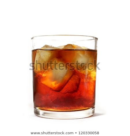A glass with iced tea and icecubes on a white background Stock photo © Zerbor