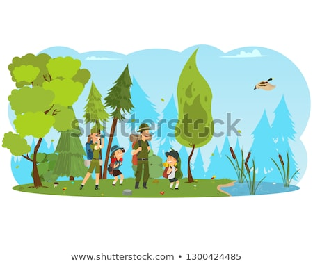 Family in hiking. Mom and son walking in the forest with trekkin Stock photo © galitskaya