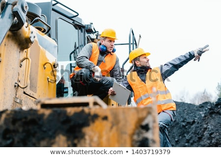 Foreman showing worker in open-cast mining pit direction Stock photo © Kzenon
