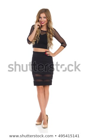 atrakcyjna · kobieta · czarna · sukienka · ręce · portret · uśmiechnięty · młodych - zdjęcia stock © filipw