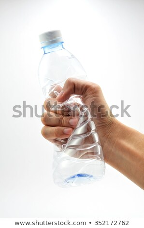 People Holding Crushed Water Bottles Stock photo © AndreyPopov