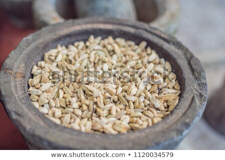Pods of green cardamom in a large pottery Stock photo © galitskaya