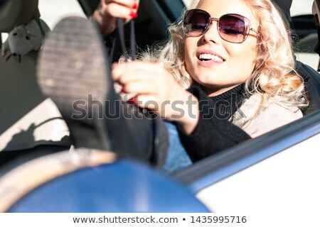 Young blond female driver tying her laces Stock photo © Giulio_Fornasar