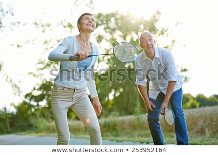 Summer Vacation of People, Badminton Game Outdoors Stock photo © robuart