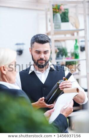 Genç barmen yeni şarap şişesi sakallı her ikisi de Stok fotoğraf © pressmaster