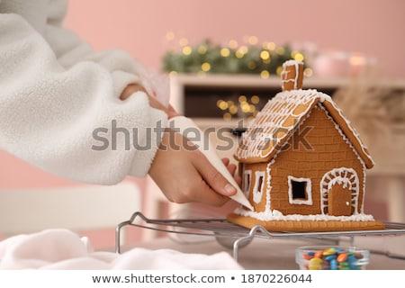 Vrouw peperkoek huizen christmas koken Stockfoto © dolgachov