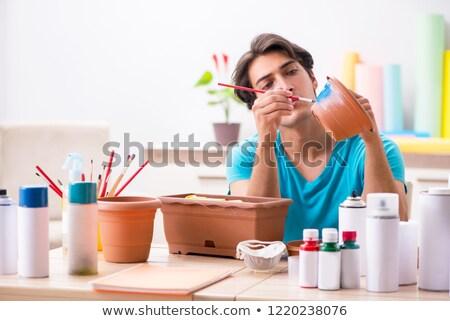 Fiatalember cserépedények osztály kéz munka terv Stock fotó © Elnur