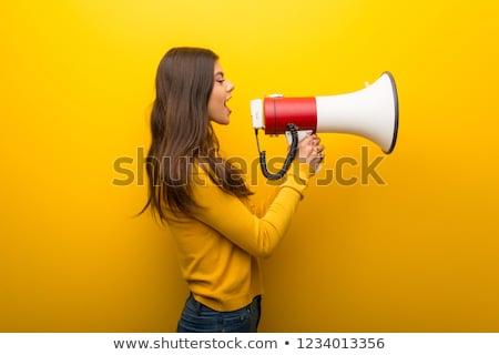 Jeune femme adolescente mégaphone communication féminisme personnes Photo stock © dolgachov