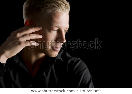 Low key portrait of young handsome man looking down. Stock photo © lichtmeister