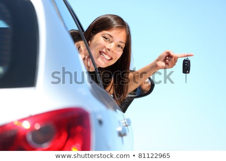 the happy woman showing the key of her new car stock photo © nobilior