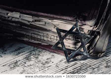 old book and star of david on a rustic surface Stock photo © nito