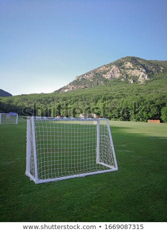 Football field in mountainous terrain. Children's football gates against the backdrop of mountains a Stock photo © ElenaBatkova