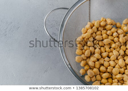 Half cropped shot of sieve full of dry chickpeas. Vegan protein source. Healthy diet and vegetarian  Stock photo © vkstudio