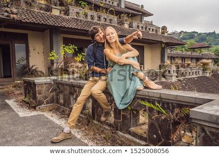 Szczęśliwy para miłości opuszczony tajemniczy hotel Zdjęcia stock © galitskaya