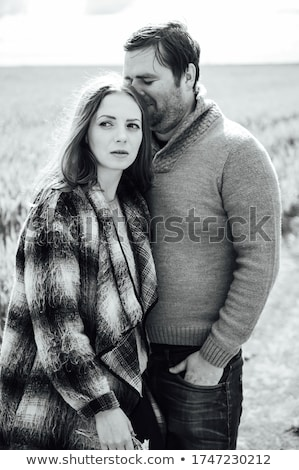 Young lovers walk near the field of early wheat. Hug and have fun Stock photo © ruslanshramko