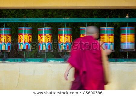 Buddhist monk rotating prayer wheels in McLeod Ganj Stock photo © dmitry_rukhlenko