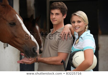 Young couple at a riding stable Stock photo © photography33