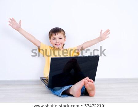 счастливым мало мальчика ноутбука движущихся отдельно Сток-фото © dacasdo