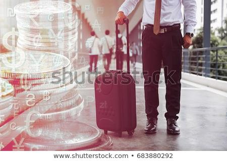 man stood by dollar and euro symbols stock photo © photography33
