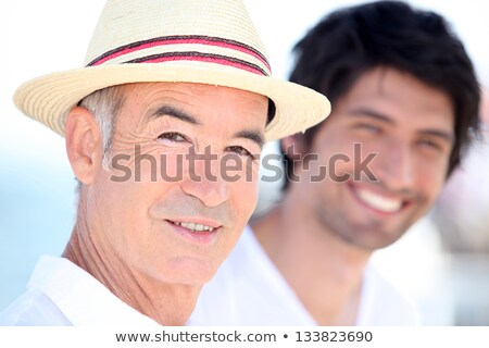 Father and son enjoying each other's company on a sunny summer's day Stock photo © photography33