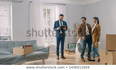 estate agent welcoming couple stock photo © photography33