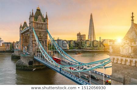 Tower Bridge Londres laranja pôr do sol céu água Foto stock © 5xinc