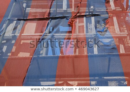 abandoned building with torn debris netting Stock photo © sirylok