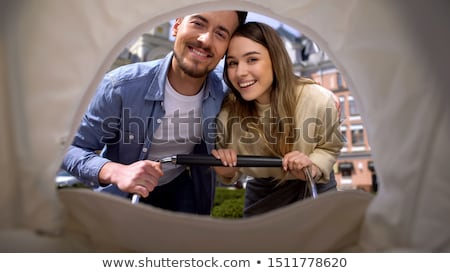 happy couple with baby stroller stock photo © vg