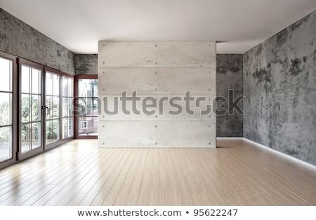Foto stock: Empty Room Illuminated With Light From Window
