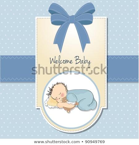 little baby boy sleep with his teddy bear toy baby shower card stock photo © balasoiu