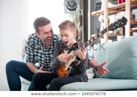 Człowiek nauczania syn gitara model włosy Zdjęcia stock © photography33