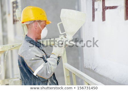 Man spraying inslation into walls Stock photo © photography33