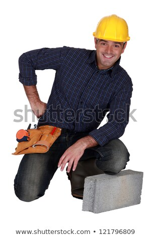 craftsman posing next to a stone block Stock photo © photography33