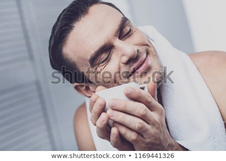Young man pressing a towel to his face Stock photo © photography33